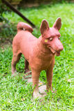 Thai dog statue on grass Stock Images