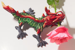Thai dragon with a pink rose. Royalty Free Stock Photo