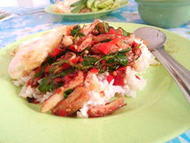Rice topped with crabmeat and basil Royalty Free Stock Image