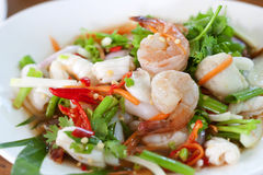 Thai dressed spicy salad. With prawn, shrimp, green herbs onion and chili: delicious food Stock Photography