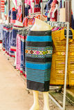 Thai dresses  on the rail Stock Photo