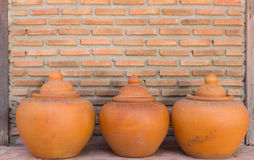 Thai earthenware. Brick Wall with Thai earthenware Stock Photography