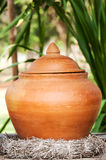 Thai earthenware for put water Royalty Free Stock Image