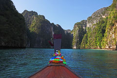 The Thai excursion boat swims in a bay Stock Photography