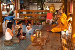 Thai Family pay respects to buddhist monks Stock Images