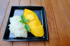 Thai famous dessert: Mango with sticky rice topping with coconut milk Stock Photo