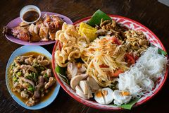 Thai traditional food set north east style. Thai famous dish papaya salad with chicken grilled and spicy pork salad stock image