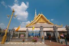 Thai famous temple Wat Sothorn. The golden color of Thai famous temple Wat Sothorn and the blue sky Stock Photo