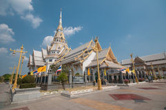 Thai famous temple Wat Sothorn. The golden color of Thai famous temple Wat Sothorn and the blue sky Stock Image