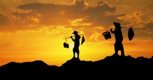 Thai farmer on sunset Stock Photos