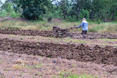 Thai farmer using walking tractors for cultivated soil for prepare plantation Stock Photography