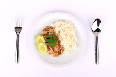 Thai Favorite Dish, Fried sliced pork with garlic with rice and cucumber Stock Photo