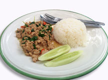 Thai favorite dish. Steamed rice with fried pork and basil Stock Photo