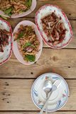 Thai favorite menu papaya `Som-Tum`. Serve with grilled pork on wooden table royalty free stock photos