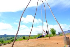Thai female was playing wooden the swings at Khao Kho, Phetchabun, Thailand stock photos