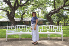 Thai female woman wearing thai tradition clothes standing in park of king palace Stock Images
