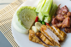 Thai fermented pork fried and vegetable. Thai fermented pork fried food is one. Made with meat, like a sour pork with rice, sugar, salt and saltpeter sour taste royalty free stock photography