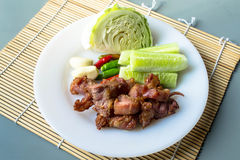 Thai fermented pork fried and vegetable. Thai fermented pork fried food is one. Made with meat, like a sour pork with rice, sugar, salt and saltpeter sour taste stock photo