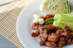 Thai fermented pork fried and vegetable. Thai fermented pork fried food is one. Made with meat, like a sour pork with rice, sugar, salt and saltpeter sour taste royalty free stock photo