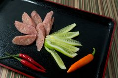Thai Fermented Sausages with Chillies and Cucumber Stock Images