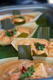 Thai fish. Boat-shaped bowls of salmon prepared with Thai sauce stock photos