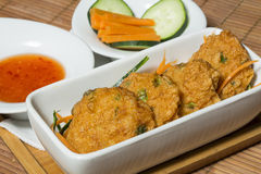 Thai fish cakes with chili sauce Royalty Free Stock Photography