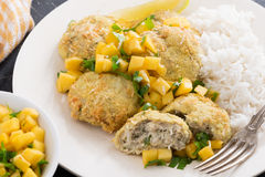 Thai fish cakes with mango salsa and rice on a plate Royalty Free Stock Photos