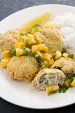 Thai fish cakes with mango salsa and rice on a plate, close-up Stock Image