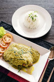 Thai fish fillet with asian green curry sauce meal Stock Photos