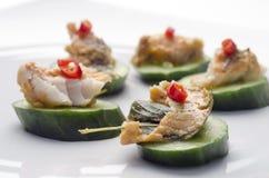 Thai fish pâté and cucumber canapés Stock Photo