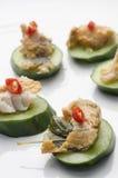 Thai fish pâté and cucumber canapés Royalty Free Stock Photos