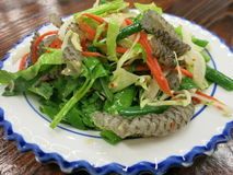 Thai Fish Skin Salad on White Plate. A dish of Thai Fish Skin Salad on a white place on a table Stock Photography