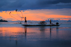 Thai fisherman in action ,Thailand Stock Photography