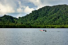 Thai fisherman on long tail boat on Koh Chang island. royalty free stock images