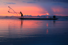 Thai fisherman with net in action. Thai fisherman in action ,Songkhla,Thailand Royalty Free Stock Photography