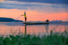 Thai fisherman with net in action Stock Photo