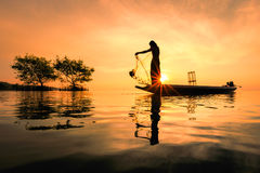 Thai fisherman with net in action. Thailand Royalty Free Stock Image