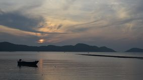 Thai fisherman prepares to sail for Fish in the sea at sunset ,timelape stock video footage