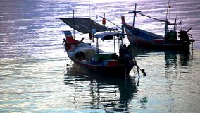 Thai fisherman prepares to sail for Fish in the stock video footage