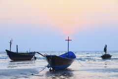 Thai fishery boat on sea beach against beautiful dusky sky use f Royalty Free Stock Photography