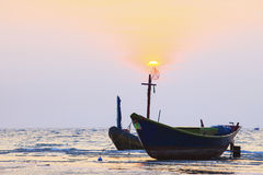 Thai fishery boat on sea beach against beautiful dusky sky use f Royalty Free Stock Image