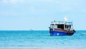 Thai fishing in blue sea Royalty Free Stock Photos