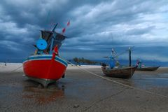 Thai fishing boat in cloudy sky. A view of a red Thai fishing boat floating in cloudy sky Stock Photos