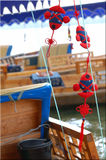 Thai fishing boat decorations. Red and blue ornaments decorating a Thai fishing boat Royalty Free Stock Photos