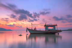 Thai fishing boat used as a vehicle for finding fish in the sea. Stock Image