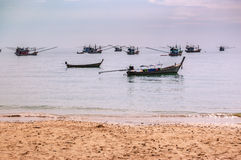 Thai fishing boats at anchor off beach Royalty Free Stock Images