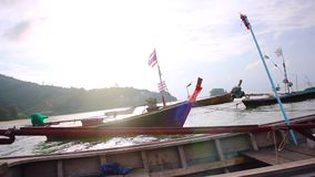 Thai Fishing Boats Nai Yang Beach in Phuket Thailand stock video