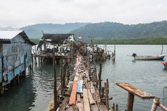 Thai fishing village on wooden stilts in the sea. Travel. Stock Image