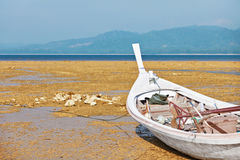 Thai fishing wooden boat on the coast Royalty Free Stock Photography