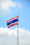 Thai flag against blue sky Royalty Free Stock Image